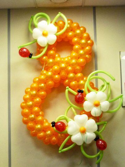 Восьмерка с цветами и божьими коровками